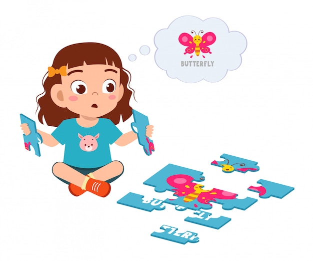 Happy cute little kid girl play puzzle