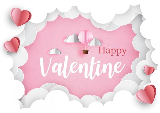 Happy valentine lettrage avec ballon rose dans le trou géant de nuages et coeurs rouges sur rose. carte de voeux saint valentin en papier découpé style et design.