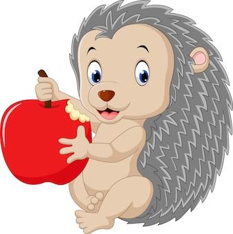 Hérisson mignon bébé tenant la pomme