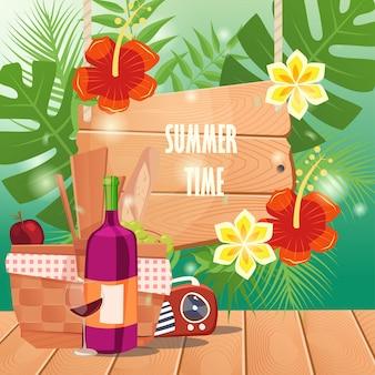 Heure d'été avec panier pique-nique sur une table en bois