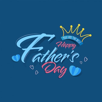 Heureuse calligraphie de la fête des pères avec couronne d'art en ligne et coeurs coupés en papier sur fond bleu.