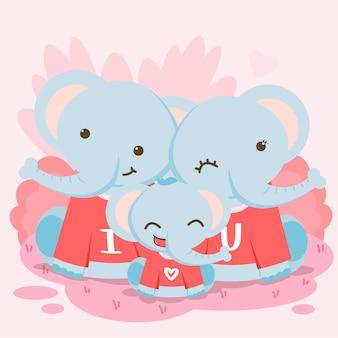 Heureuse famille d'éléphants posant avec le texte je t'aime