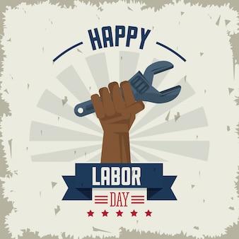 Heureuse fête du travail avec une clé de tenue de main américaine afro