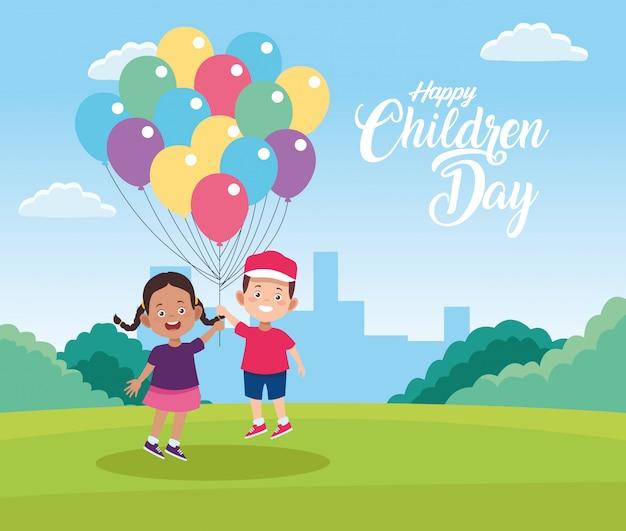 Heureuse fête des enfants avec des enfants jouant avec des ballons à l'hélium