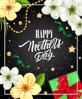 Heureuse fête des mères lettrage dans le cadre avec boîte-cadeau et fleurs. carte de voeux fête des mères.