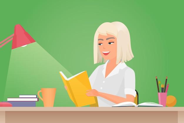 Heureuse fille lisant un livre jeune étudiante assise au bureau pour lire une histoire de travail littéraire