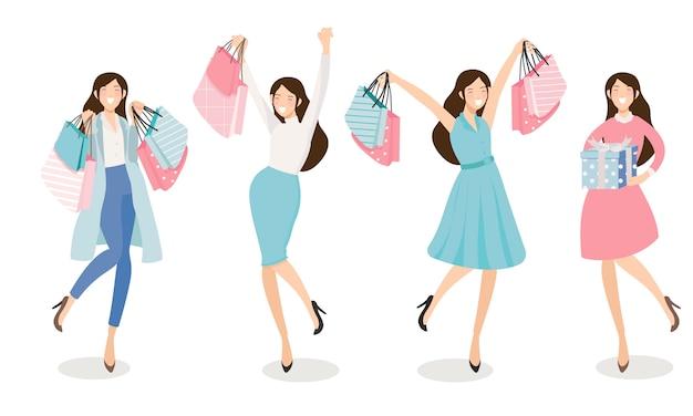 Heureuse jeune femme shopping dans les tons bleu et rose
