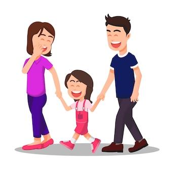 Heureuse petite famille marchant ensemble et se tenant la main