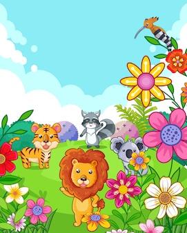 Heureux animaux sauvages mignons avec des fleurs jouant dans le jardin