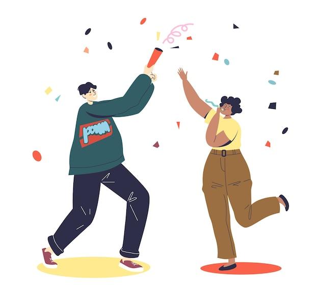 Heureux couple célébrant l'événement de vacances avec cracker et confettis.
