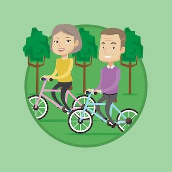 Heureux couple de personnes âgées à cheval sur des vélos dans le parc