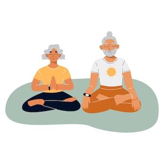 Heureux couple de personnes âgées faisant du yoga pose de lotus