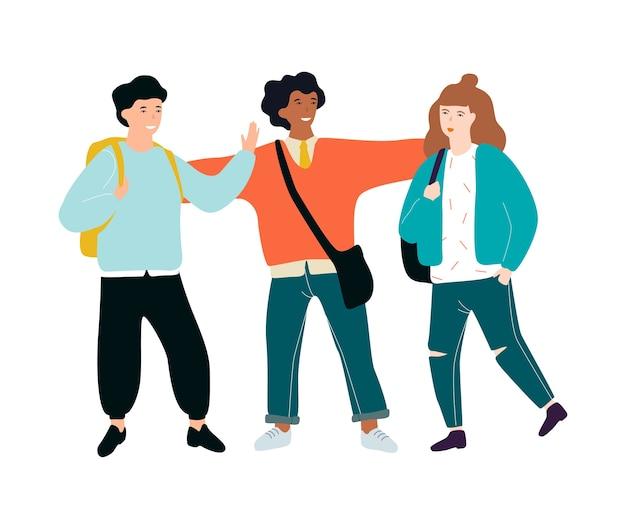 Heureux les écoliers debout ensemble. enfant avec sac à dos