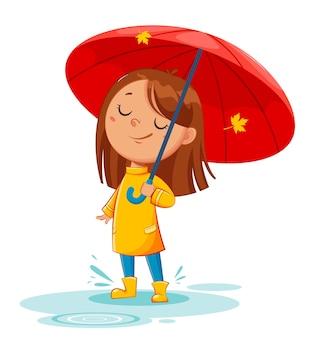 Heureux enfant drôle dans des bottes en caoutchouc debout sous un parapluie, automne pluvieux. fille joyeuse