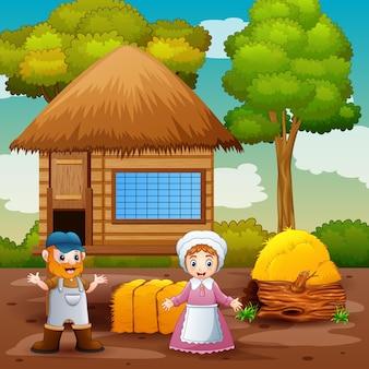 Heureux le fermier homme et femme dans la ferme