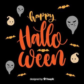 Heureux fond de lettrage de halloween avec des fantômes