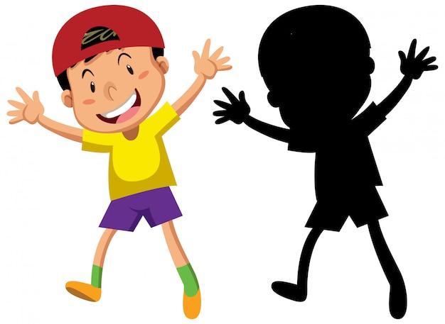 Heureux garçon dansant avec sa silhouette