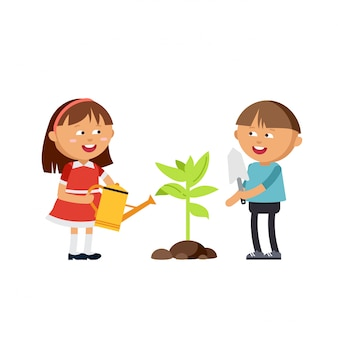 Heureux garçon et fille faisant un jardin