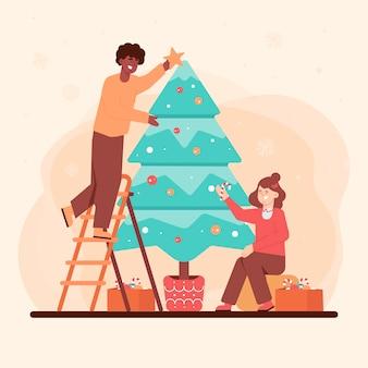 Heureux gens décorer un arbre de noël