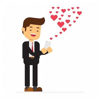 Heureux homme envoyant un sms d'amour