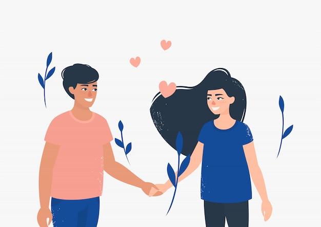 Heureux homme et femme amoureux se tiennent par la main, entourés de fleurs