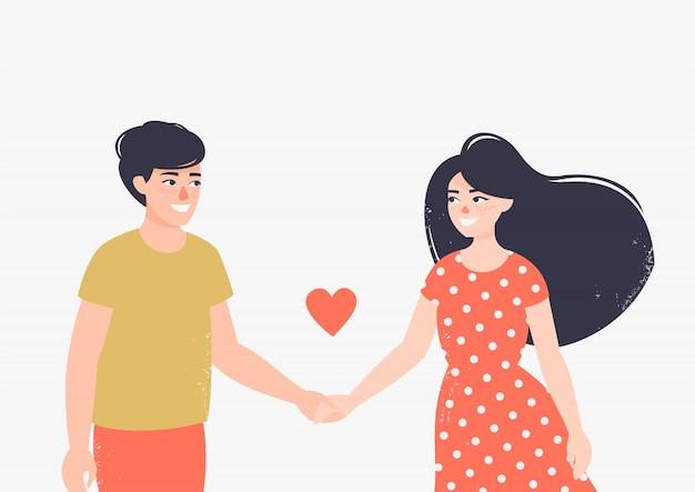 Heureux homme et femme amoureux se tiennent par la main