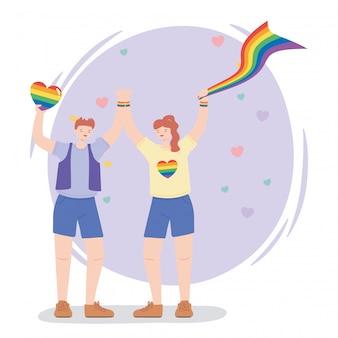 Heureux homme et femme avec drapeau arc-en-ciel et coeur
