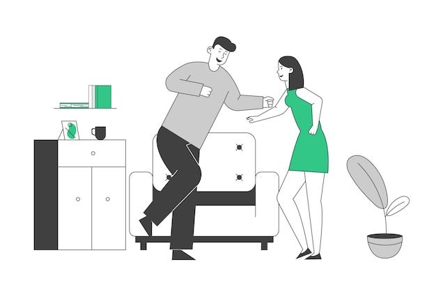 Heureux homme et femme passent du temps ensemble à la maison danser et s'amuser.