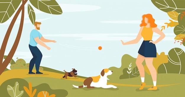 Heureux homme et femme propriétaire d'un animal de compagnie chien marche dans le parc