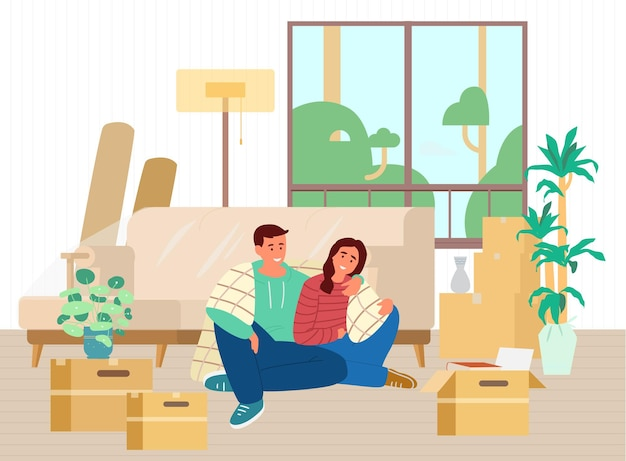 Heureux jeune couple vient d'emménager dans une nouvelle maison assis sur le sol parmi des boîtes et des meubles déballés