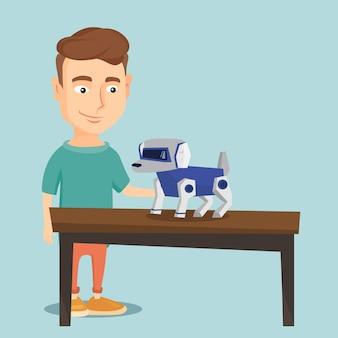Heureux jeune homme jouant avec un chien robotique.