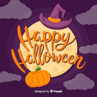 Heureux lettrage d'halloween avec la pleine lune