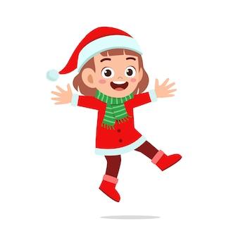 Heureux Mignon Petit Garçon Et Fille Portant Un Costume De Noël Rouge Et Sauter Vecteur Premium