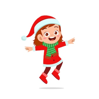 Heureux mignon petit garçon et fille portant un costume de noël rouge et sauter