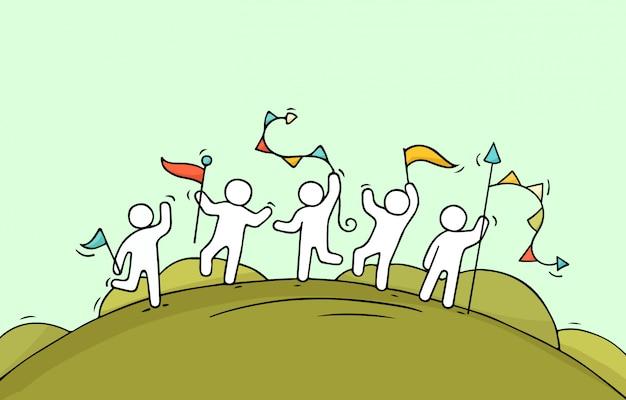 Heureux petits gens avec des guirlandes et des drapeaux