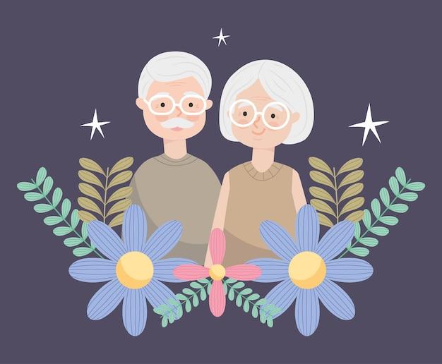 Heureux vieux couple avec des fleurs et des feuilles décoratives