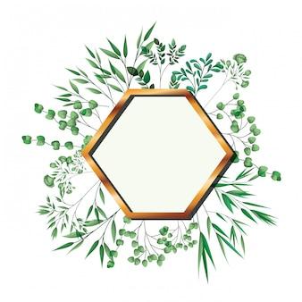 Hexagone cadre doré avec feuillage isolé