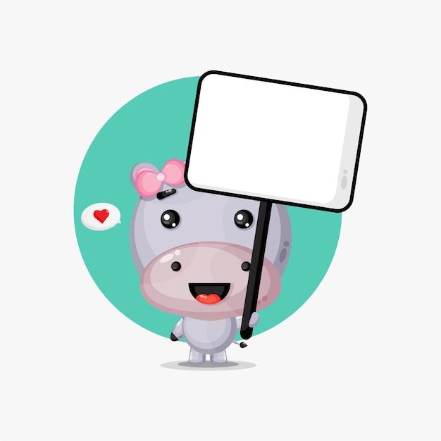 Hippo mignon tenant une pancarte blanche