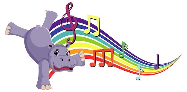 Hippopotame dansant avec des symboles de mélodie sur l'arc-en-ciel
