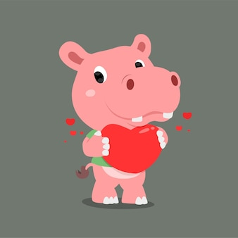 Hippopotame avec joli visage tenant un grand coeur dans sa main