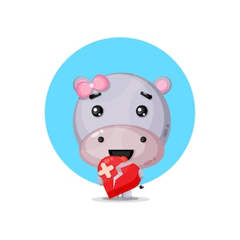Hippopotame mignon avec coeur brisé