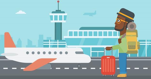 Homme à l'aéroport avec valise.