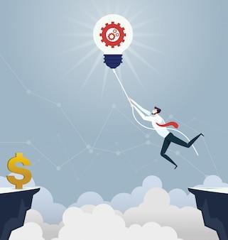 Homme d'affaires accroché la corde à travers le fossé - concept d'entreprise
