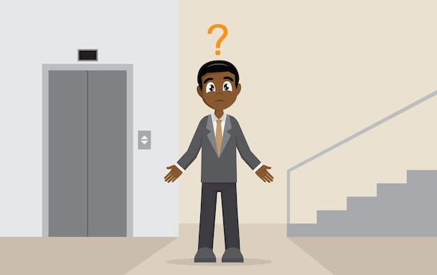 Homme d'affaires africain choisir entre l'ascenseur ou l'escalier.