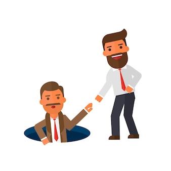 Homme d'affaires aidant son ami en le sortant du trou