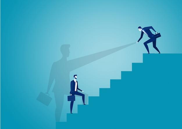 Homme d'affaires aide le partenaire à s'élever au sommet du graphique à barres rouge.