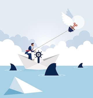 Homme d'affaires avec ampoule sur un bateau en papier