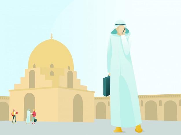Homme d'affaires arabe, parler au téléphone près de la mosquée