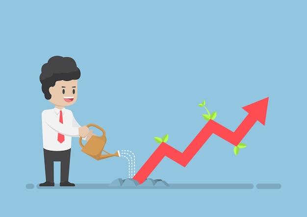 Homme d'affaires arrosage graphique d'entreprise que la croissance à travers le sol