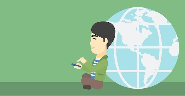 Homme d'affaires assis près du globe terrestre.